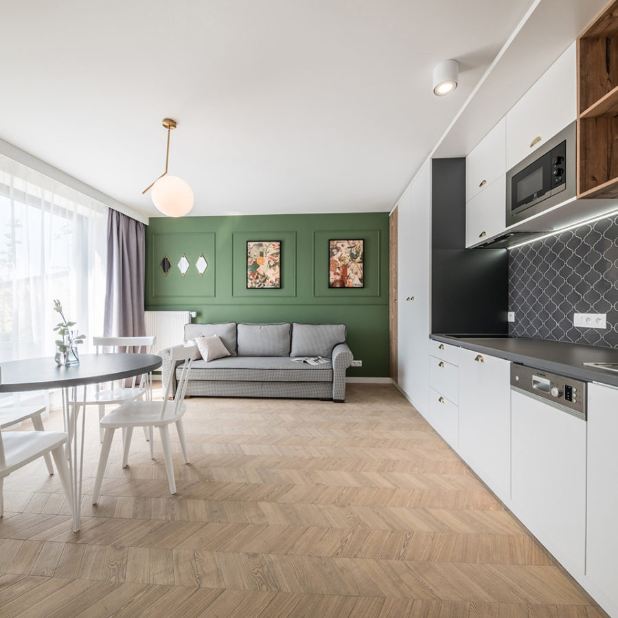 Apartments at Piłsudskiego - Scale Alhambra / Hexawood Chevron
